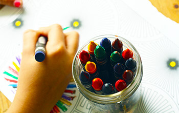 Child Drawing with Crayons